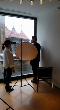 Whitney Lewis-Smith taking Jeansil Bruyère's portrait during the first LNFB photoshoot, with Rachel Kohut assisting. Photo Credit: Maya Soren.