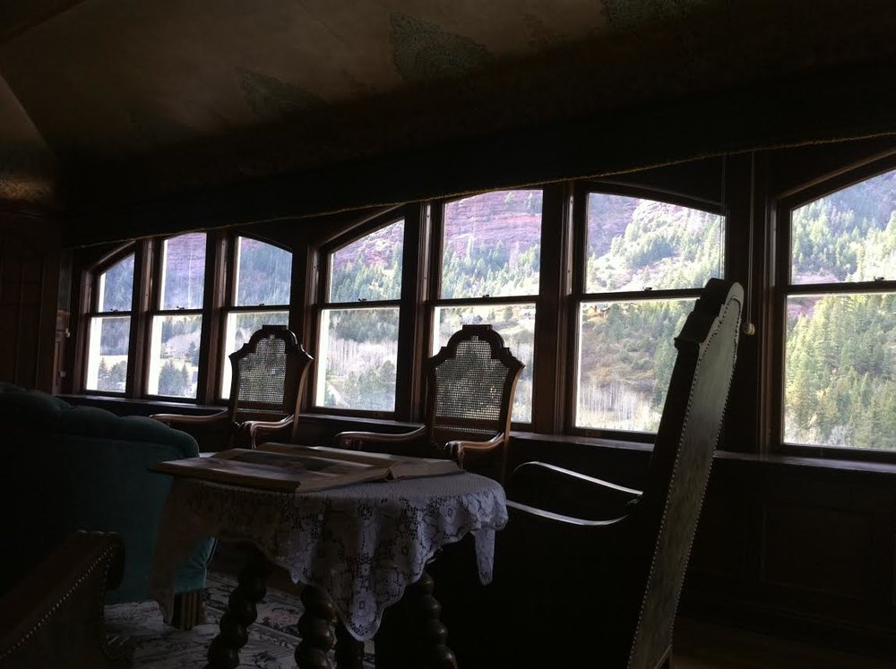 The library of Clevehom Manor designed to look like a train car.  Note the gorgeous scenery featured by the windows.