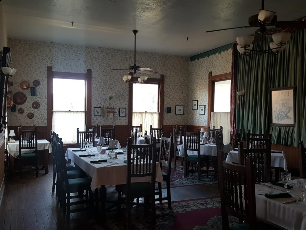 One of the beautifully restored dining areas at the Woodbine with roaming icy cold spots.