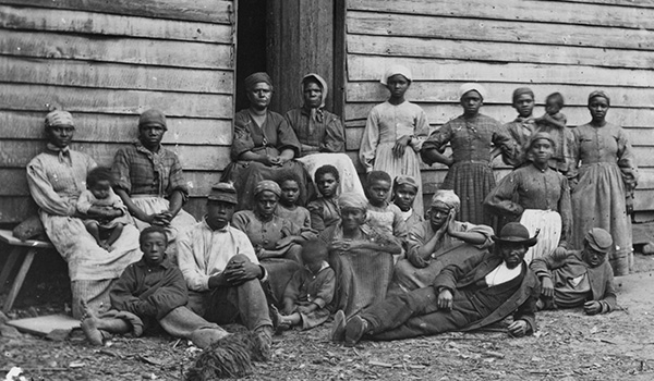 """Photo of freed slaves, now relegated to the status of """"Contraband"""" by the Union Army."""