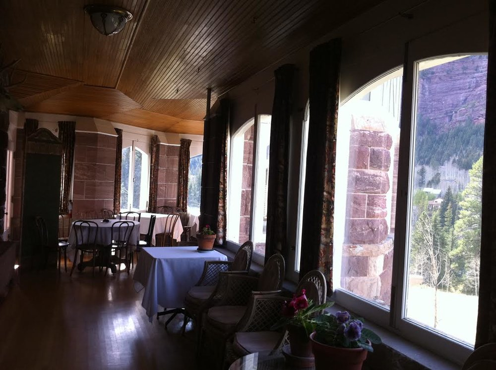 THE BREAKFAST ROOM AT CLEVEHOLM FEATURING INTRICATE PARQUET FLOORING AND LUSCIOUS MOUNTAIN VIEWS.