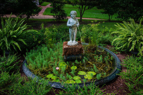 Just one of the many vignettes in Oak Hill's lush gardens. Photo courtesy of Historic Oak Hill and Doug Mauro.