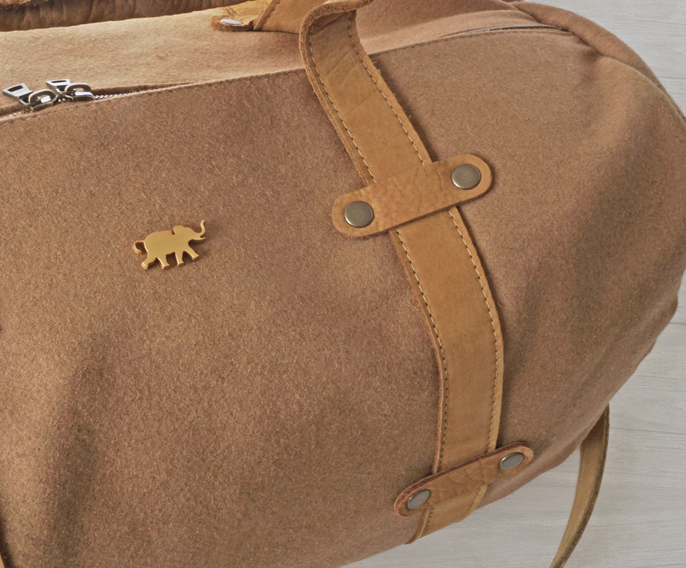 "VIRGIN CANADIAN MELTON WOOL, HANDBAG-GRADE LEATHER FROM NAPA CA. LASER-CUT ""HERMY"" BADGE (STAINLESS STEEL WITH 24c GOLD PLATING)"