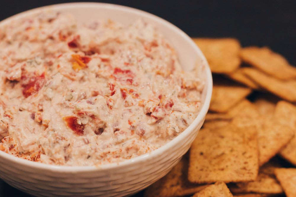 This is the perfect, guilt-free dip to serve at parties, and your friends will never suspect this Mediterranean Olive and Sun Dried Tomato Dip is a healthy snack!  www.cardiocoffeeandkale.com