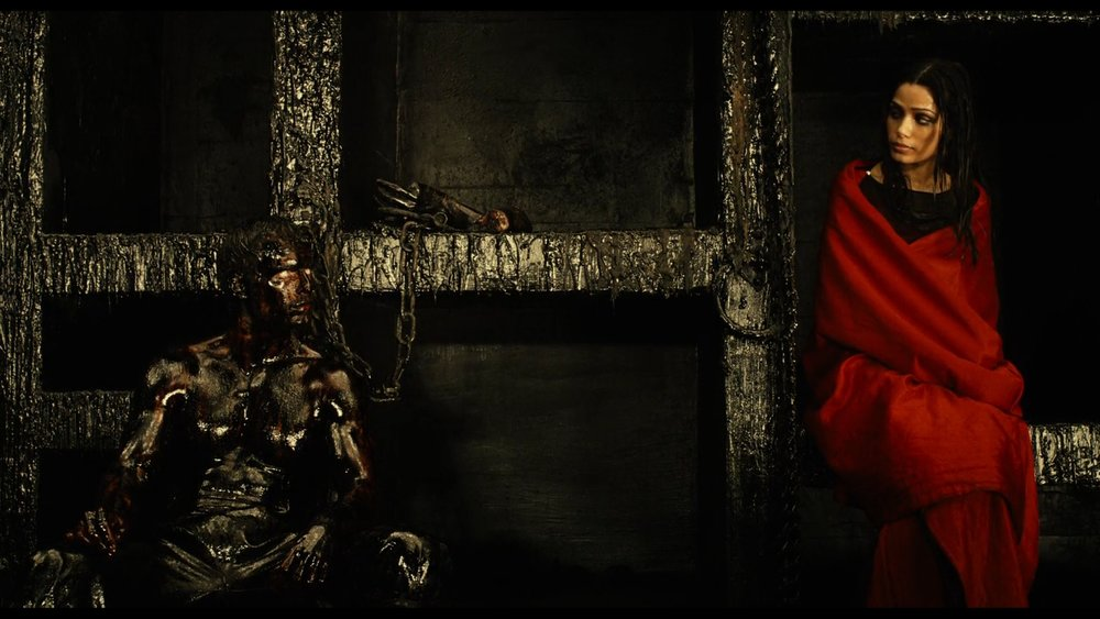 The red dress stands out thanks to the use of only darker colours in the scene.