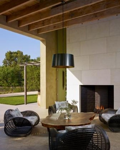 Extending the ceiling design to the covered patio brings continuity to this lovely outdoor space.