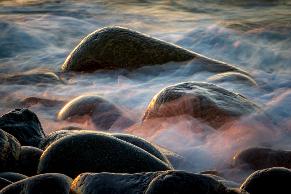 Long exposure of water flowing over the rocks at Boulder Beach in Acadia National Park.  Taken during sunrise.