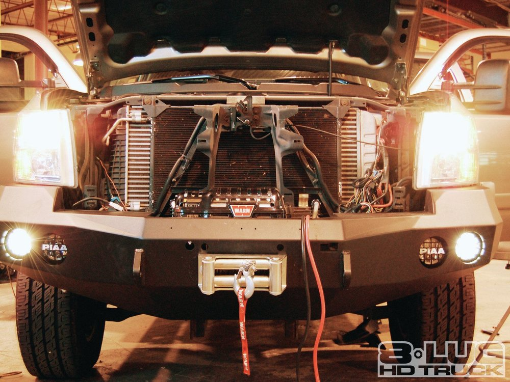 1210-8l-18+winch-time-ultimate-tow-and-work-truck-upgrades+all-four-lights-mounted.jpg