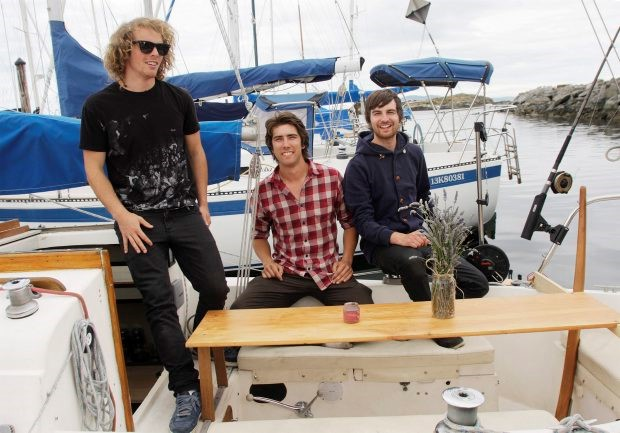 From left: Arran Jackson, Brendan Harris and Janusz Urban on a 29-ft sailboat heading for a one-month cooking discovery of Desolation Sound. Photograph by: Lyle Stafford, Times Colonist