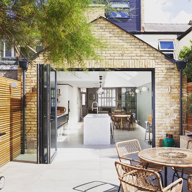 While we're on the subject of ground floor extensions, here's one we completed in Wimbledon. Indoor/outdoor flow is achieved with the use of the same tiles throughout and the pitched roof creates an airy lofty extended space. A perfect space for the summer months. #groundfloorextension #homeextension #pitchedroof