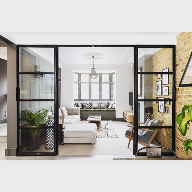 We love the Crittall doors we installed here, creating the perfect snug room with plenty of light. Glass walls & partitions continue to be popular for a reason and our @miss_jo_dyson shares some tips with @sundaytimeshome in their Trail Glazers feature this week #crittall #crittallwindows #homeinspo #homestyle #interiordesign