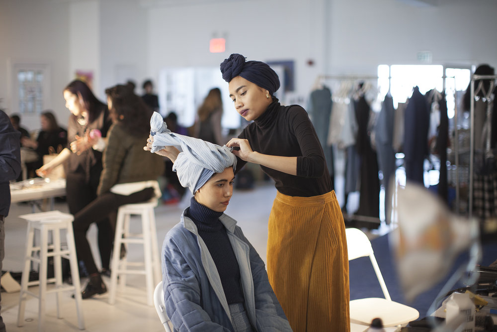 Styling a turban on a model. Photo : Adam Sinclair