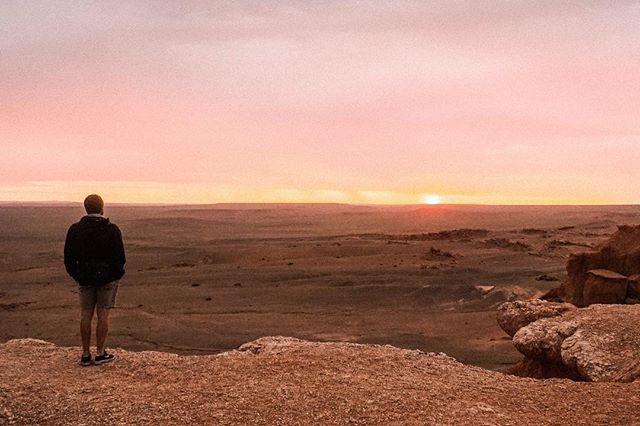 Watching my man, watching the sunrise in the middle of the Gobi Desert 🌅