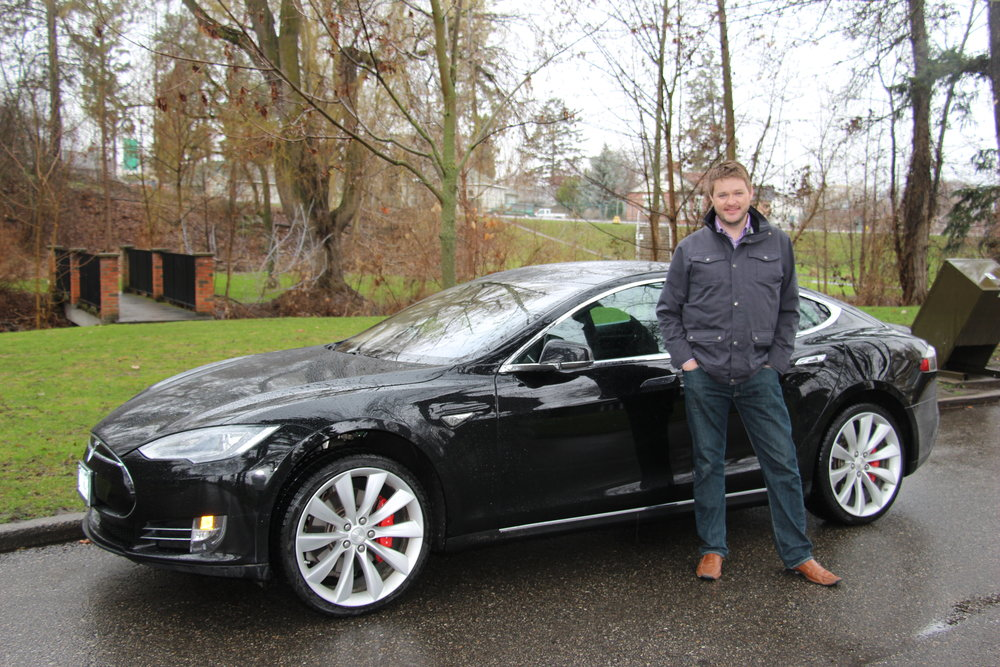 Power Trips owner, Ryan Silverthorn, with Tesla Model S P85
