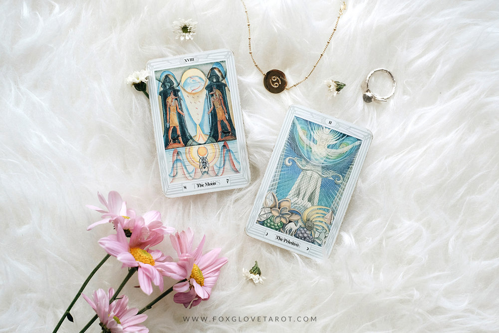 In the picture: The Moon and The Priestess of Thoth Tarot by Aleister Crowley | Cancer Gold Bracelet and Goddess Moonstone Ring by  COVEN