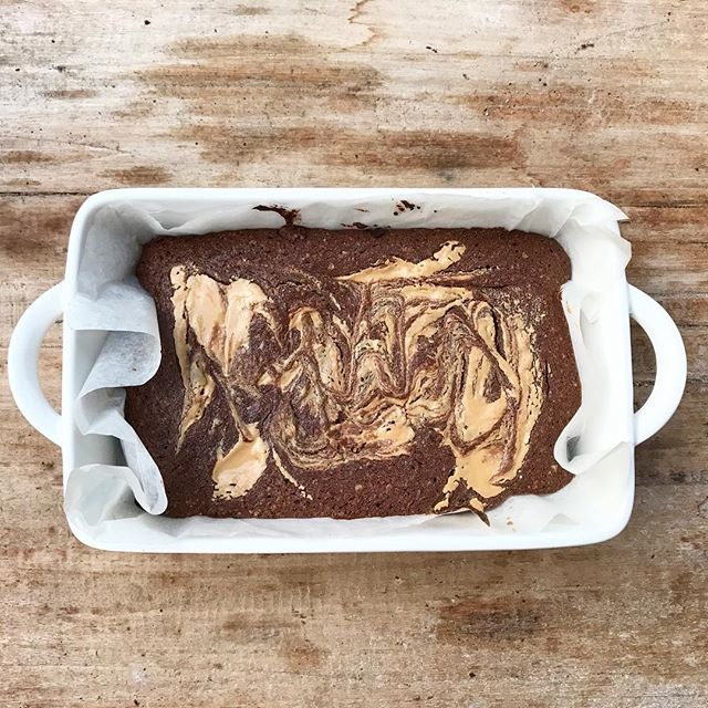 Peanut butter brownies 💚 - - In a bowl place 150g dairy free dark chocolate buttons  100g coconut oil Melt, then add to  1/2c oat flour 2tbs cacao 2 eggs 1/2c rice malt syrup Mix until just combined, pour into baking dish Heap 3/4 peanut butter (crunchy or smooth) in artistic fashion Bake at 160degrees celsius until just set Stuff in face.