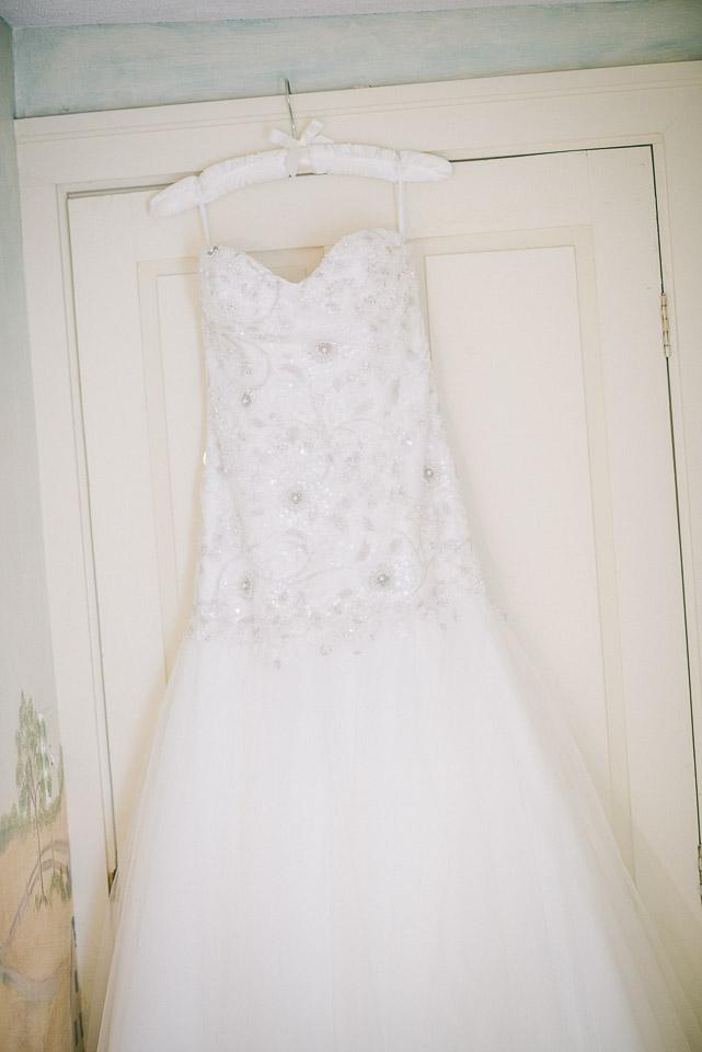 NH Wedding Photographer: bride's dress on door