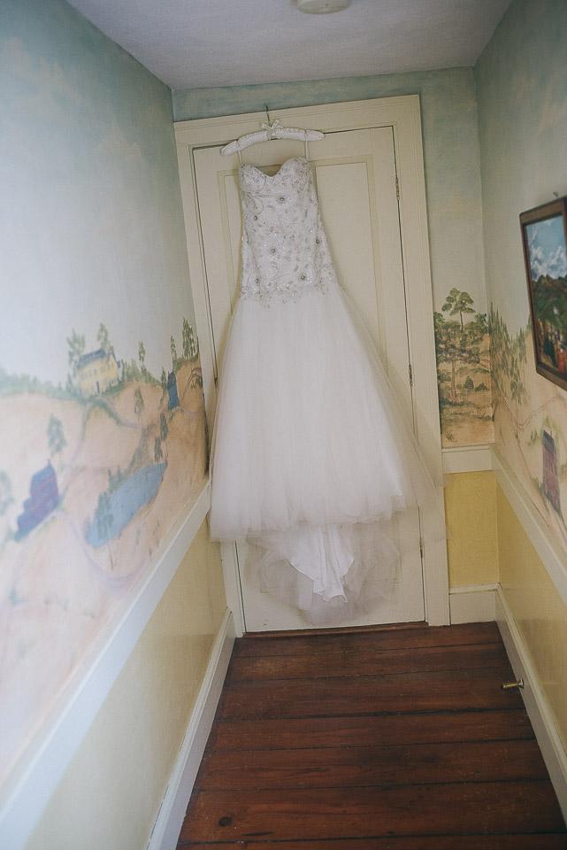 NH Wedding Photographer: dress hanging in hallway