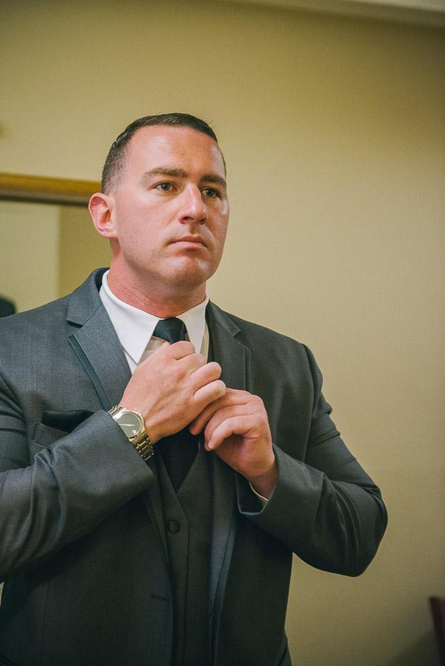 NH Wedding Photographer: groom fixing tie