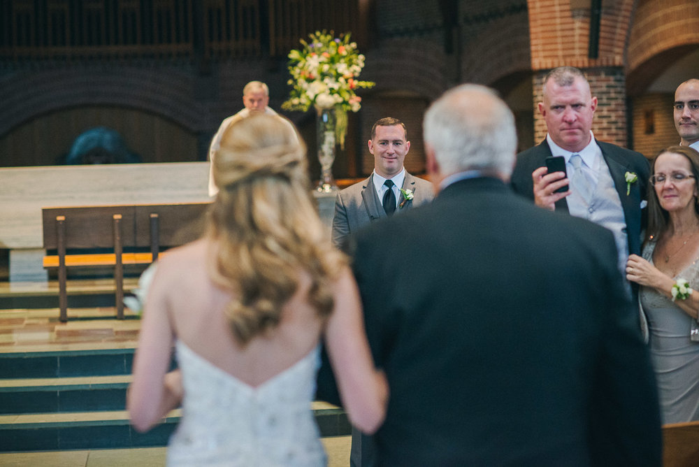 NH Wedding Photographer: groom seeing bride for first time