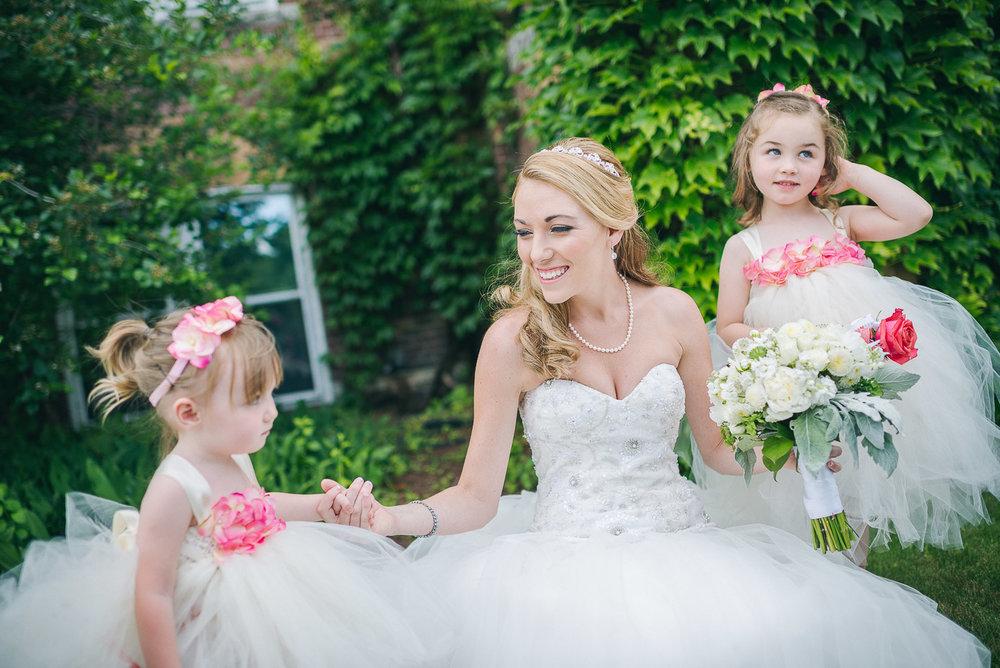 NH Wedding Photographer: flower girls with bride at Saint Anselm