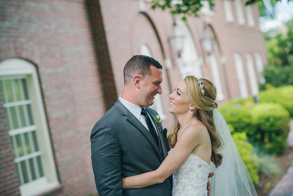 NH Wedding Photographer: newlyweds cuddling