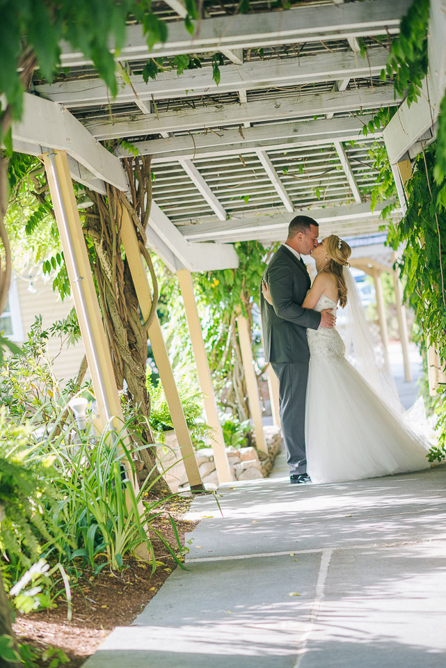 NH Wedding Photographer: bride and groom kissing