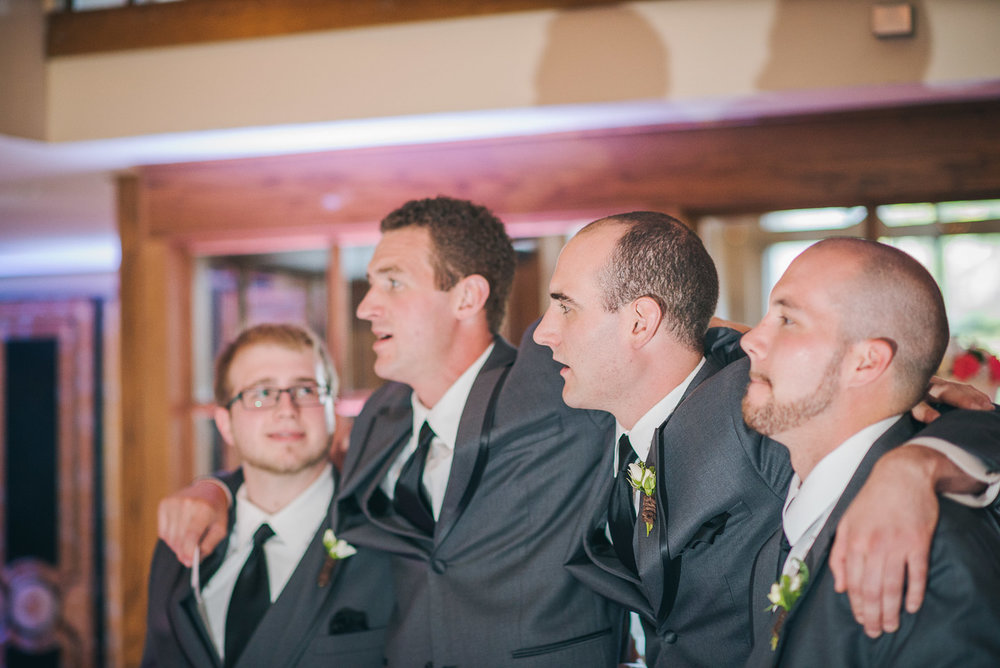 NH Wedding Photographer: groomsmen watching first dance