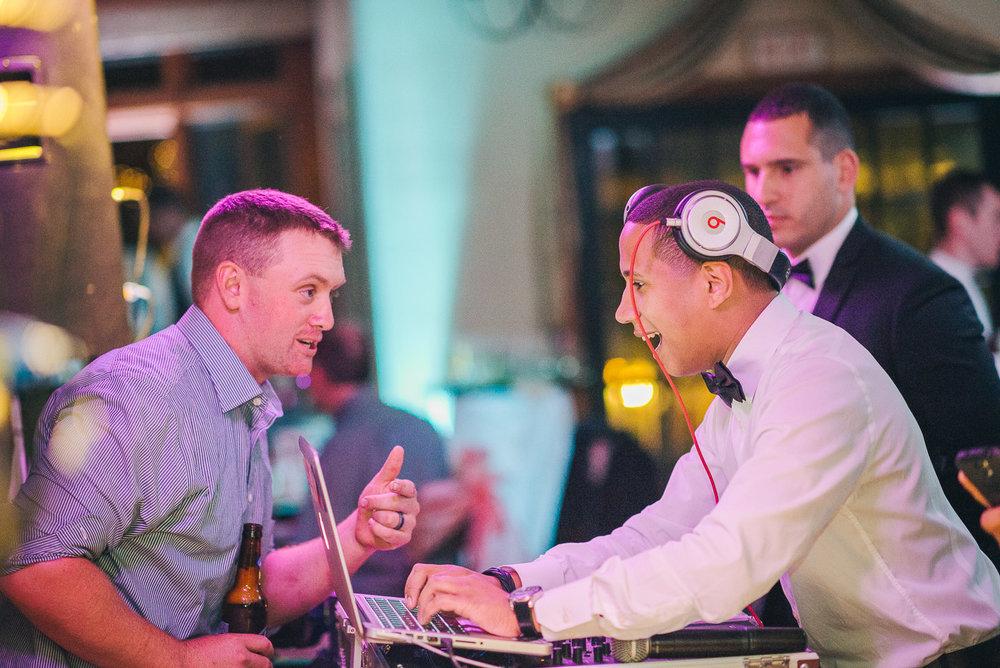 NH Wedding Photographer: DJ talking to guest