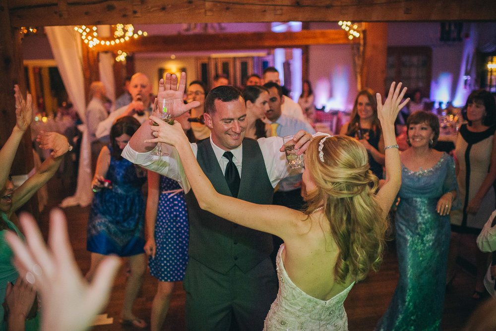 NH Wedding Photographer: guests dancing with bride and groom