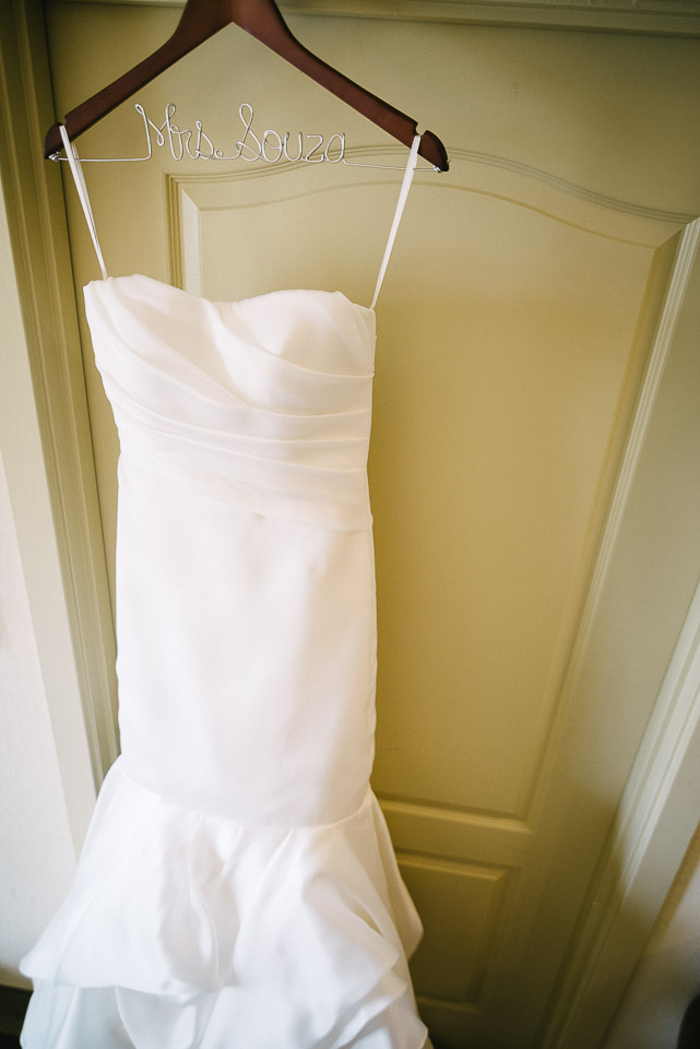 NH Wedding Photographer: brides dress on door