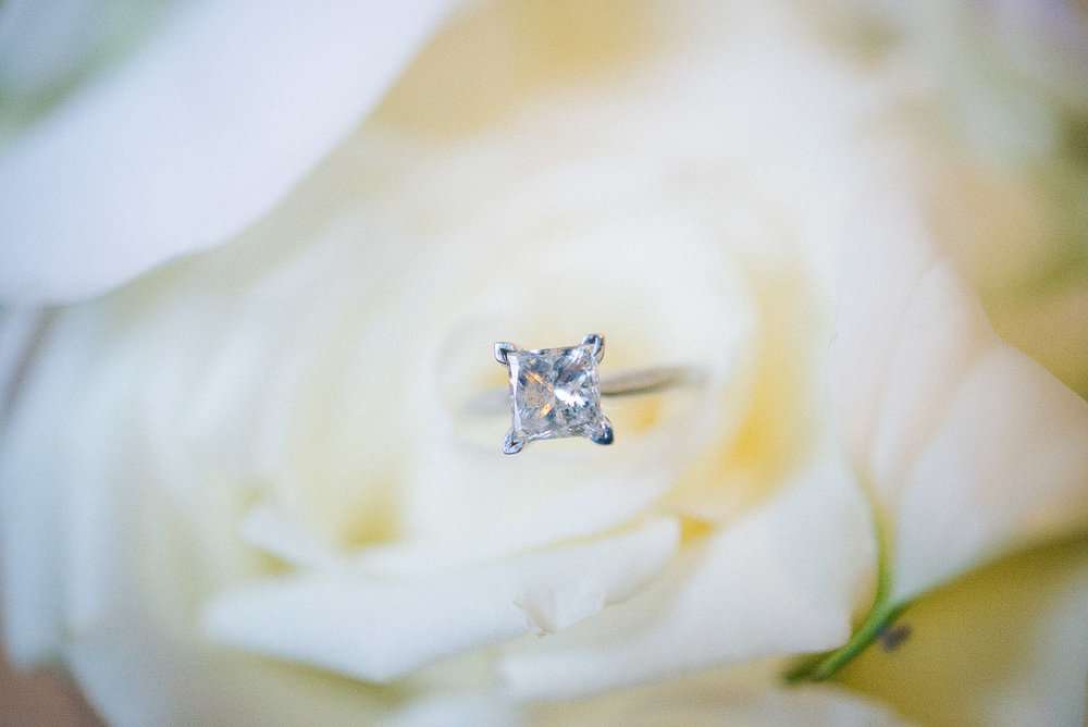 NH Wedding Photographer: engagement ring in bouquet