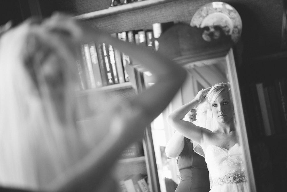 NH Wedding Photographer: bride looking into mirror