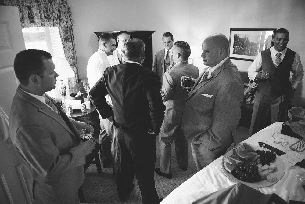 NH Wedding Photographer: groom talking getting ready