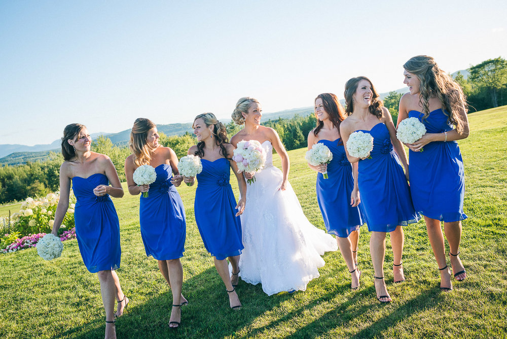 NH Wedding Photographer: bridesmaids with bride walking
