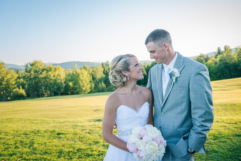 NH Wedding Photographer: bride and groom in the landscape