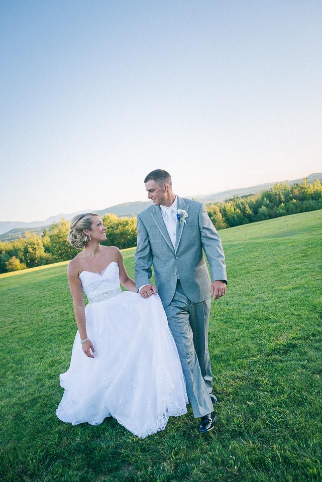 NH Wedding Photographer: newlyweds walking