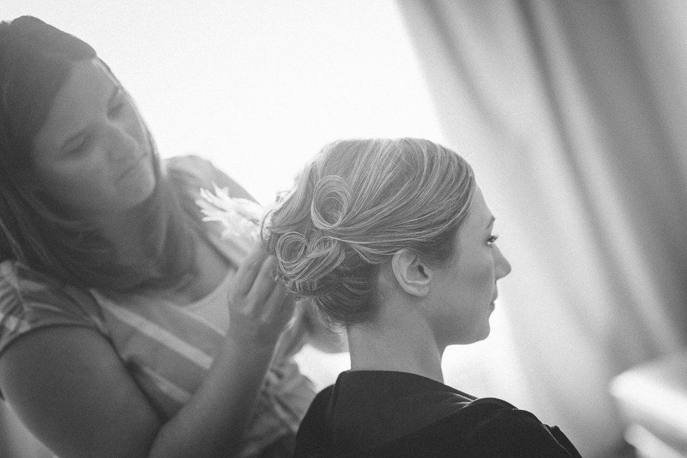 NH Wedding Photography: bride getting hair done