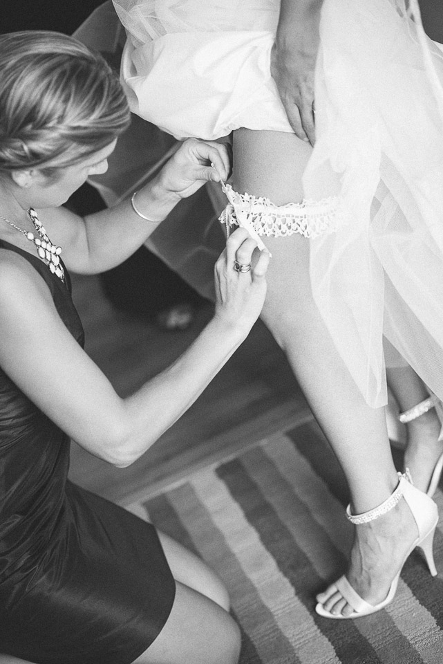 NH Wedding Photography: bride putting on garter