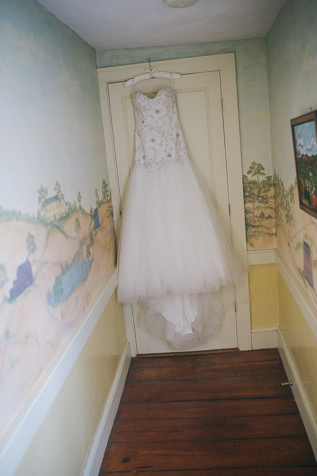 NH Wedding Photography: bride's dress in doorway