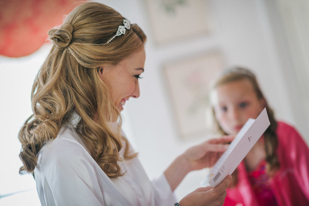 NH Wedding Photography: bride reading letter from groom