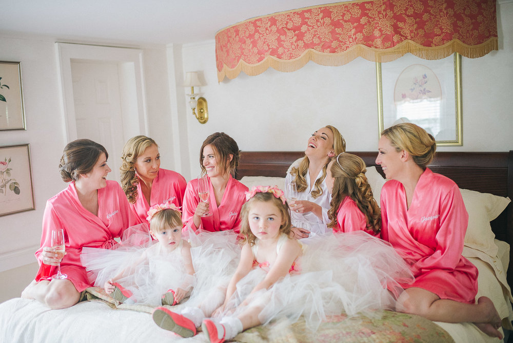 NH Wedding Photography: bride and bridesmaids in bridal suite