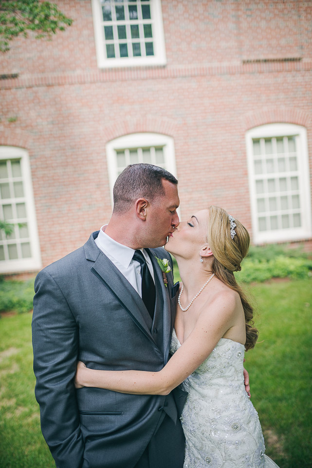 NH Wedding Photography: kissing at Saint Anselm