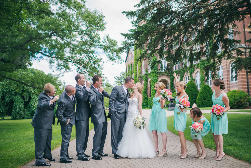 NH Wedding Photography: bridal party on campus of Saint Anselm