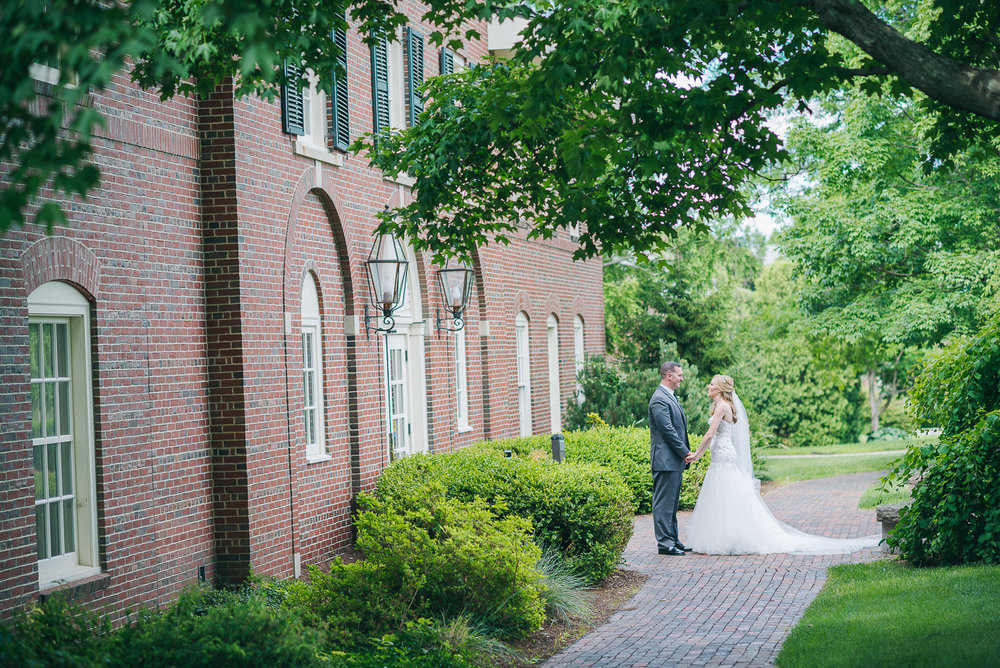 NH Wedding Photography: bride and groom on walkway