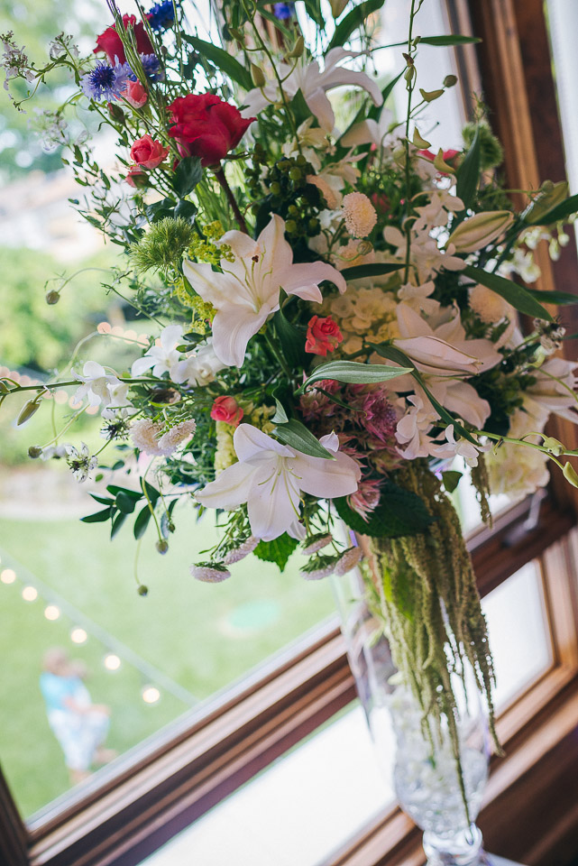 NH Wedding Photography: floral arrangement at reception