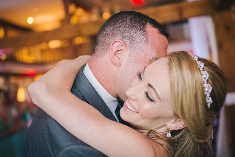 NH Wedding Photography: bride and groom hugging