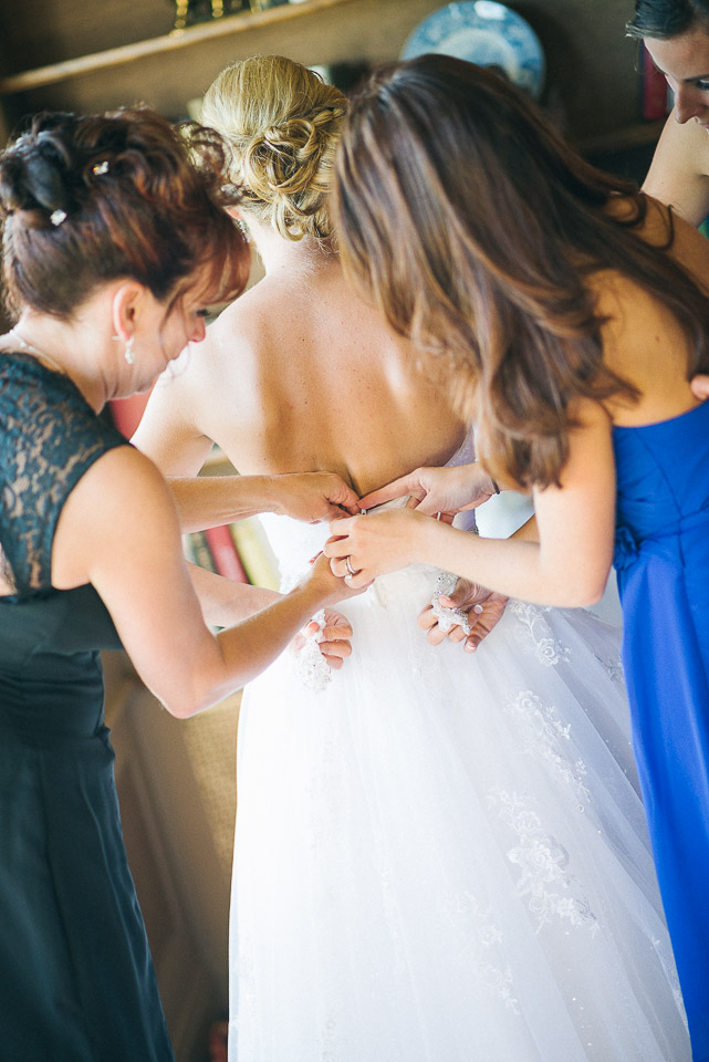 NH Wedding Photography: bride getting dressed