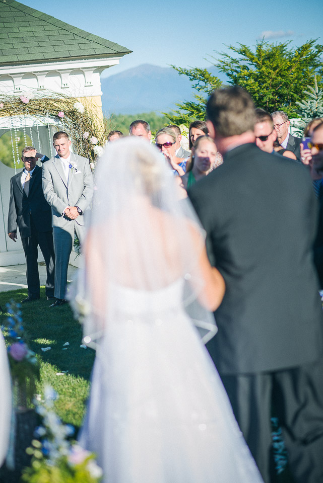 NH Wedding Photography: bride walking down aisle with dad
