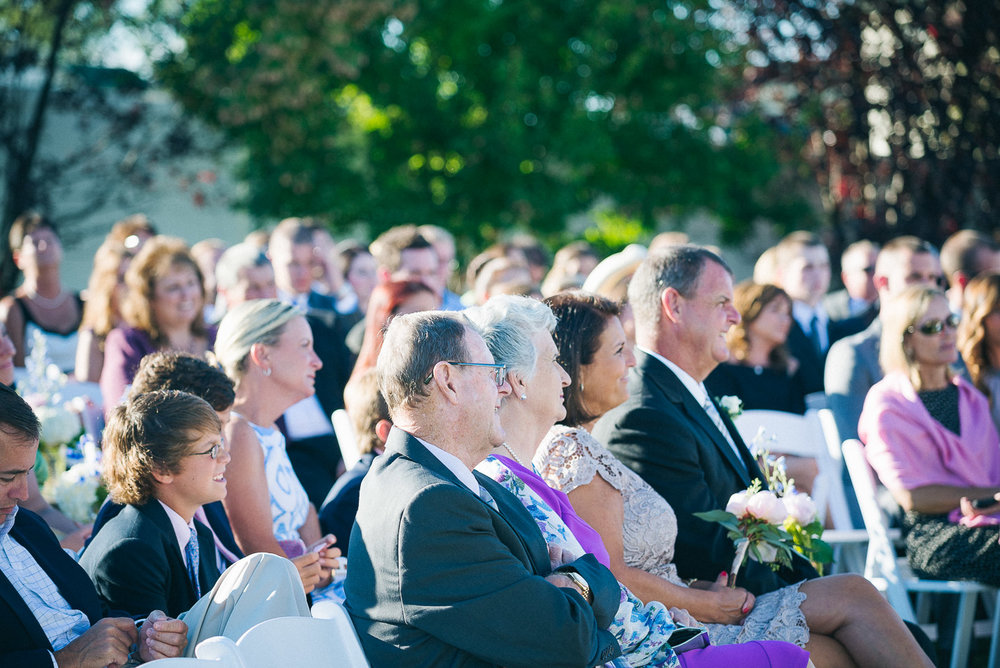 NH Wedding Photography: guests watching ceremony